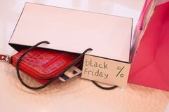 Closeup of bag with a purchase card, wallet, phone. Concept sales, black Friday Stock Photography