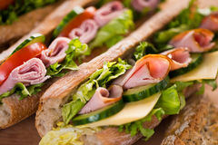 Sandwiches with ham, cheese and vegetables. Closeup of baguette sandwiches with ham and vegetables Royalty Free Stock Image