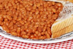 Closeup baked beans in tomato sauce with toast Royalty Free Stock Photography