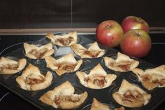 Closeup of baked biscuits with tree red apples Stock Photography