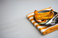 Closeup on baked pumpkin on plate Stock Photography