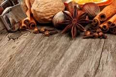 Closeup of baking ingredients and holiday spices over rustic wood Royalty Free Stock Image