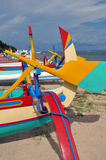 Closeup of Bali Fishing Boats at Sanur, Indonesia. Closeup view of the colorful Balinese outrigger style wooden fishing boats on the beach at Sanur, Bali Royalty Free Stock Photo