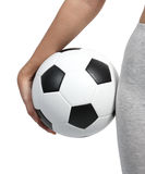 Closeup ball. Closeup image of woman holding a football in right hand beside her body Stock Photos