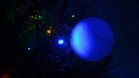 Closeup of a ball on the Christmas tree. stock video