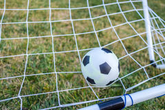 Closeup of ball and football goal Royalty Free Stock Photos
