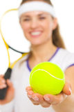 Closeup on ball in hand of female tennis player Stock Photo