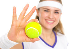 Closeup on ball in hand of smiling tennis player Royalty Free Stock Images