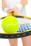 Closeup on ball on racket in hand of tennis player Royalty Free Stock Image