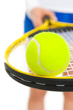 Closeup on ball on racket in hand of tennis player Royalty Free Stock Photo