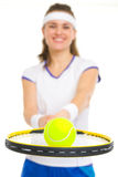 Closeup on ball on racket in hand of tennis player Stock Photo