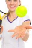 Closeup on ball throwing up by tennis player Stock Photo