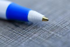 Closeup of a ballpoint pen, shallow depth of field with focus on. Top of pen. Ball point biro pen in macro photo key on fancy background. Close up focused on royalty free stock photography