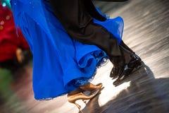 Closeup of ballroom dancers legs Stock Photos