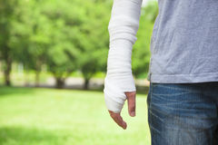 Closeup of bandaged arm  with park background Stock Photo