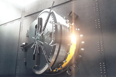 Closeup of bank vault door. Closeup of an open bank vault door with golden light peeking from inside. 3D Render Stock Photography