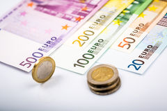Closeup of banknotes and coins Royalty Free Stock Image