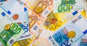 Closeup of banknotes and coins Royalty Free Stock Photos
