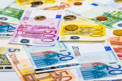 Closeup of banknotes and coins Stock Image