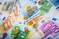 Closeup of banknotes and coins Stock Photography
