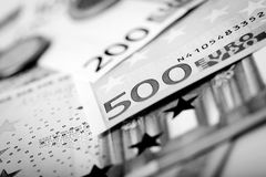 Closeup of banknotes and coins Stock Images