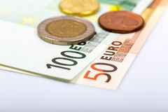 Closeup of banknotes and coins Royalty Free Stock Photos