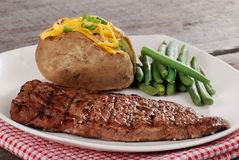 Closeup barbecue steak with vegetables Stock Image