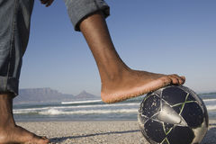 Closeup Of Barefeet With Soccer Ball On Beach Royalty Free Stock Photography