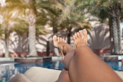 Closeup barefoot woman legs at the resort. Happy feet in tropical paradise Royalty Free Stock Image