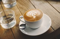 Closeup of barista made coffee with froth art stock image