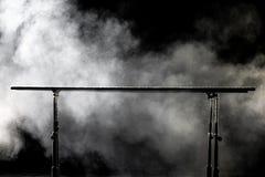 closeup bars gymnastisk parallel på svart bakgrund med dimma, royaltyfri bild