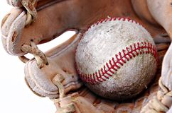 Closeup of baseball in glove Royalty Free Stock Images