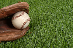 Closeup baseball glove and ball Stock Images