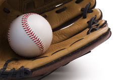 Closeup of baseball glove holding baseball royalty free stock photo