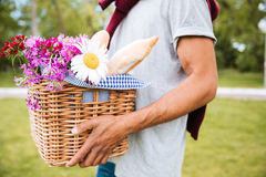 Closeup of basket with food and flowers for picnic Stock Images