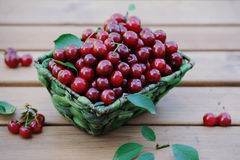 Closeup basket of fresh ripe cherries on the wooden table Royalty Free Stock Photos