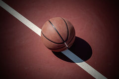 Closeup basketball ball on outdoor court Royalty Free Stock Photo