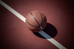 Closeup basketball ball on outdoor court Royalty Free Stock Photo