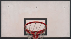 Closeup of basketball board under cloudy sky in a school yard. C Stock Images