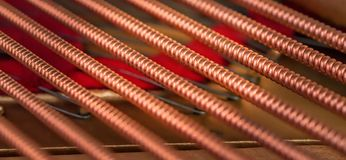 A closeup of the bass strings in a grand piano. royalty free stock photo