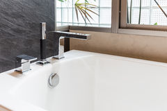 Closeup bathtub faucet Stock Photos
