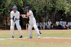 Closeup of batsman waiting for the ball to hit Stock Image