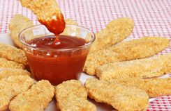 Closeup BBQ sauce with chicken fingers. Dipping royalty free stock images