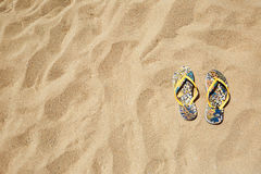 Closeup Beach Sandals Flip Flops or Tongs Sandy  Background Copyspace. Summer Concept. Horizontal. No body photo. Royalty Free Stock Photo