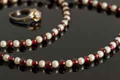 Closeup beads with garnet and white pearls and silver ring Stock Images