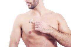 Closeup of bearded man shaving chest Stock Image