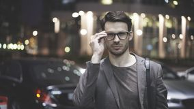 A closeup of a bearded man on the street at night stock images