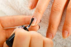 Woman in beauty salon getting manicure done. Royalty Free Stock Photos
