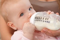 Closeup beautiful baby with nursing bottle Stock Images