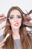 Closeup of beautiful blond girl getting makeup Royalty Free Stock Images